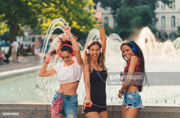 girls dancing to music - bulgarian girl stock photos and pictures