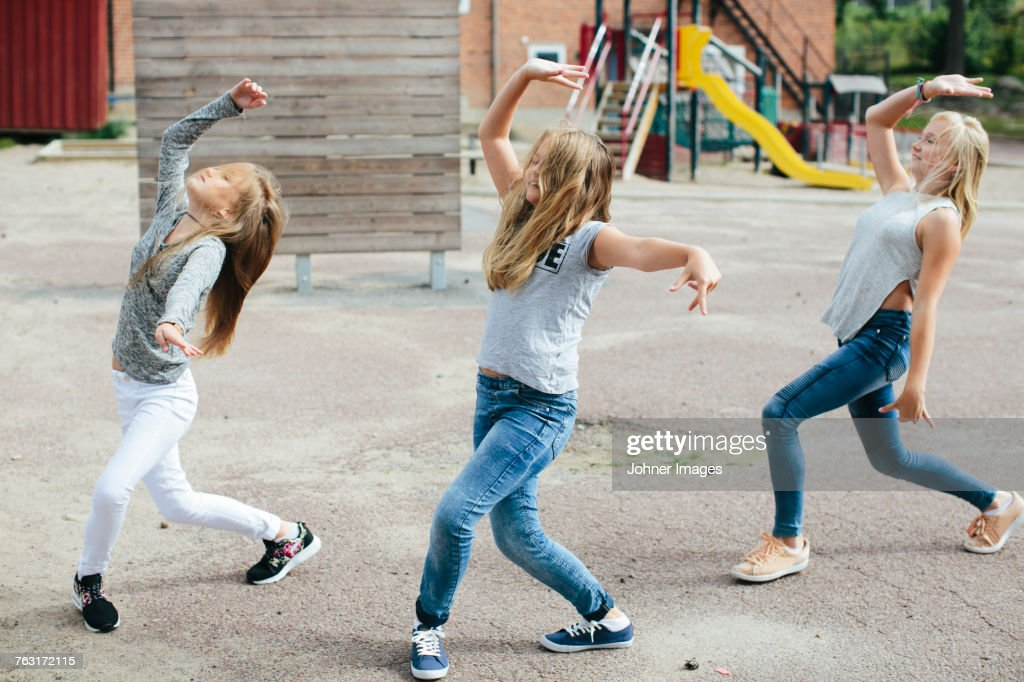 Girls dancing together : Stock Photo