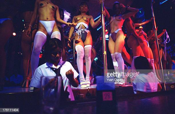 Girls dancing topless in the infamous Patpong road red light district in central Bangkok Visits to the red light district which is populated by gogo...