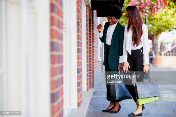 girl's day out at london's shopping district - fashion collection stock pictures, royalty-free photos & images