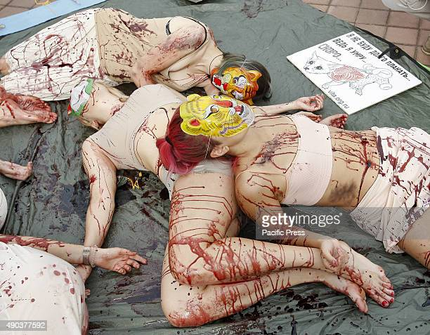 Girls depicting carcasses of animals without fur as victims of fur industry during a protest Bloody bunch Ukrainian animal rights activists organized...