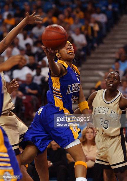 3/22/2003 – Girls Div 1 state championship basketball game between Lynwood High and Archbishop Mitty at Arco Arena in Sacramento Sade Wiley–Gatewood...