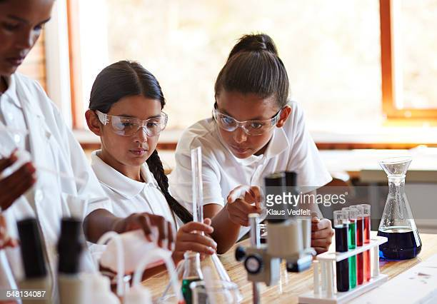 Girls doing science experiments in classroom