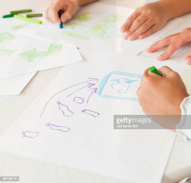 Girls drawing recycling pictures