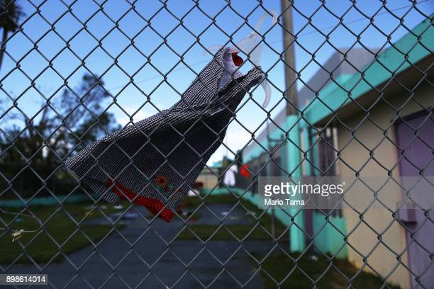 A girl's dress hangs to dry on a fence in a shelter for Hurricane Maria victims on Christmas day on December 25 2017 in Toa Baja Puerto Rico 12...