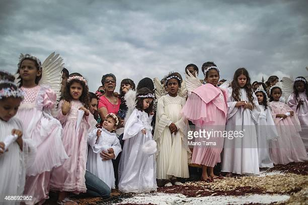 Girls dressed as angels stand at the annual Easter procession during traditional Semana Santa festivities on April 5 2015 in Ouro Preto Brazil Holy...