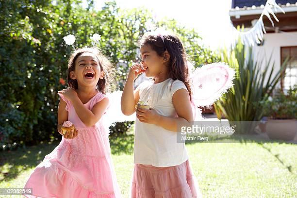 Girls dressed as fairies in garden