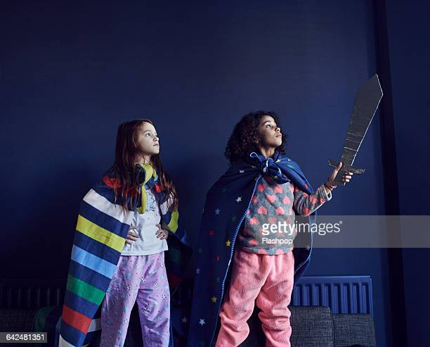 girls dressed as superheroes - side by side stock pictures, royalty-free photos & images