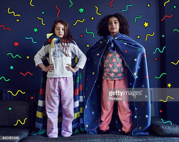 girls dressed as superheroes with graphic symbols - superhero stock pictures, royalty-free photos & images