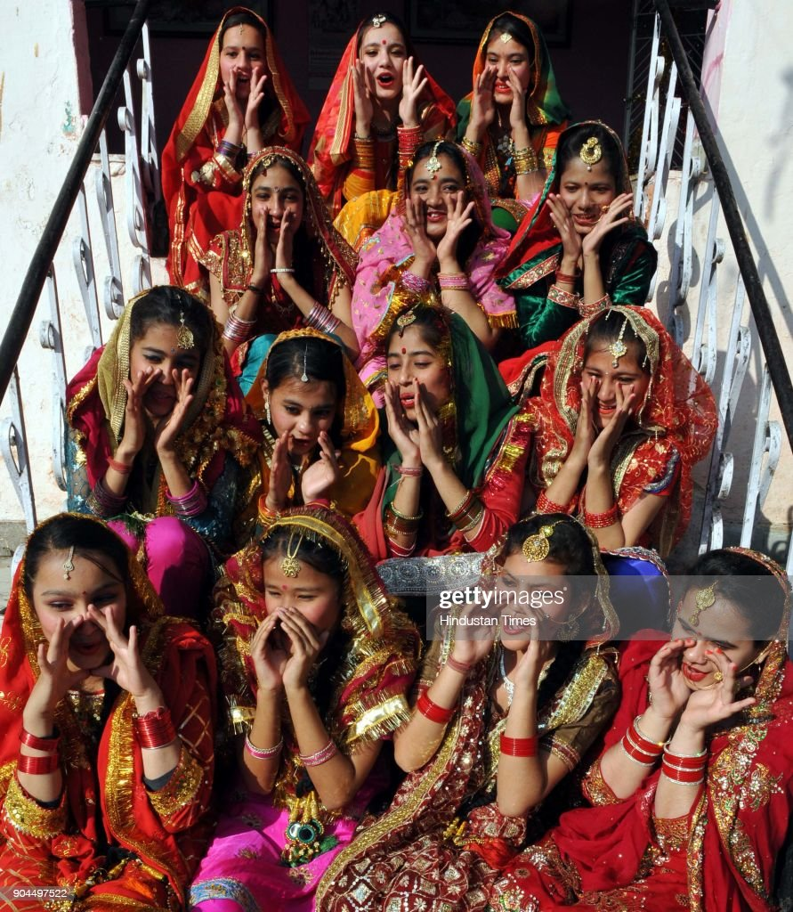 Girls dressed in their traditional attire as they celebrate Lohri festival, on January 13, 2018 in Jammu, India. Lohri is a great occasion that holds great importance for farmers. The festival of harvest, Lohri is being celebrated in North India especially in Punjab, Haryana, Himachal Pradesh and Delhi. Popcorns, peanuts, Rewari and Gajak are distributed to all neighbours, friends and relatives on the occasion.