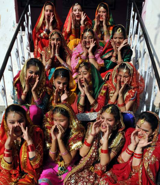 Girls dressed in their traditional attire as they celebrate Lohri festival on January 13 2018 in Jammu India Lohri is a great occasion that holds...