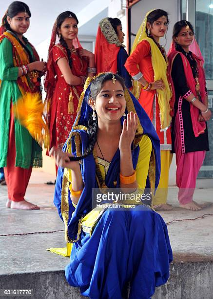 Girls dressed in traditional attire dance around a bonfire as they celebrate Lohri festival on January 13 2017 in Jammu India Lohri is a harvest...