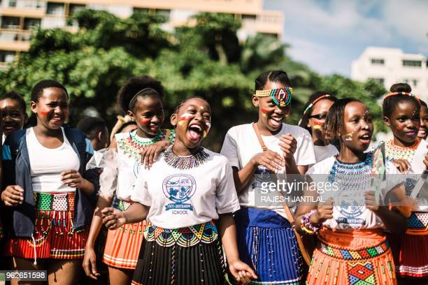 Girls dressed in traditional attire sing and chant in Durban as they take part on May 26 2018 in a street carnival festival celebrating Africa Month...