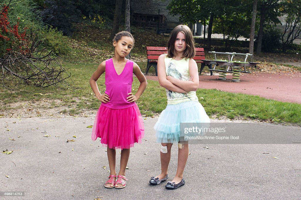 Girls dressed in tutus with tough expression on faces : Stock Photo