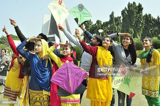 Girls dressed in yellow take part in Kite flying on the occasion of Basant Panchami Festival at Punjabi University Basant Panchami is a Hindu...
