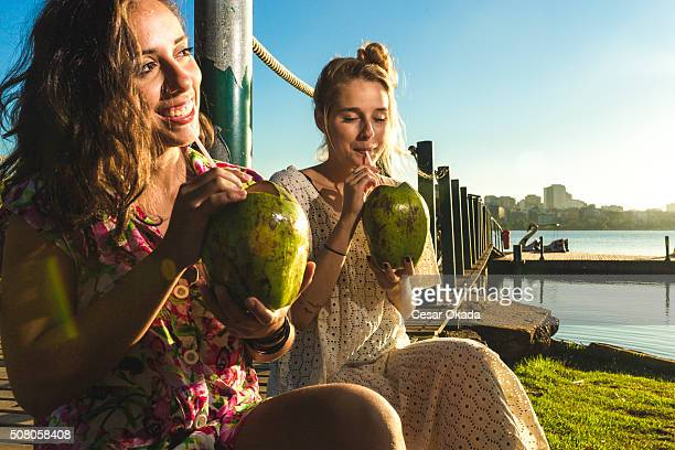 girls drinking coconut water - coconut water stock pictures, royalty-free photos & images