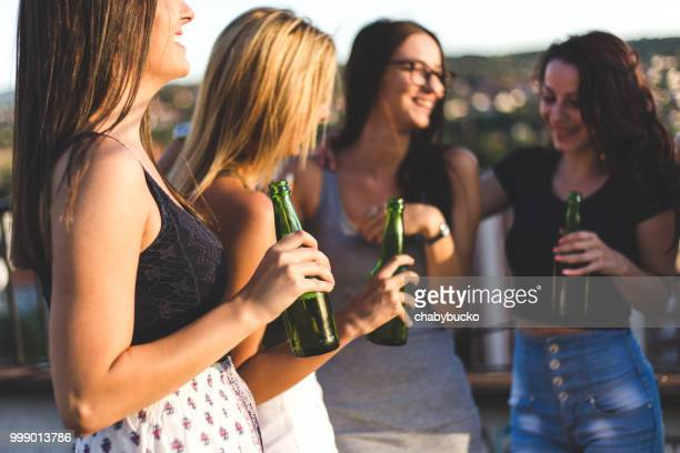 Girls drinks beer at party