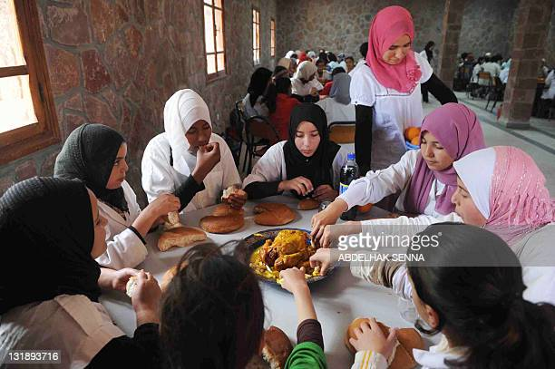 Girls eat lunch at a hostel in the Ourika mountain region near Marrakech on April 14 2011 The hostel is one of 300 centers in Morocco where girls...