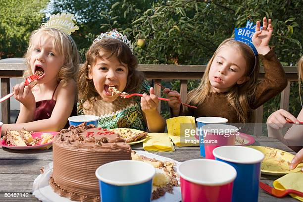 Girls eating birthday cake