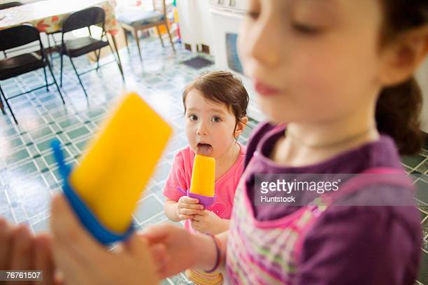 girls eating ice pops - lolly models stock pictures, royalty-free photos & images