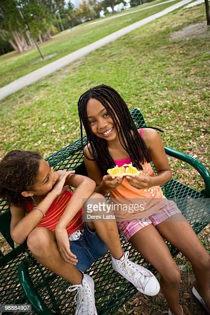 Girls Eating Orange