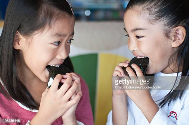 girls eating rice balls, japan - rice ball stock pictures, royalty-free photos & images