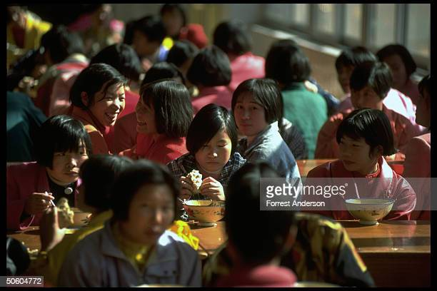 Girls eating soup at communal tables prob. At school in prospering Maoist commune-style wholly collective town Nanjie Cun.