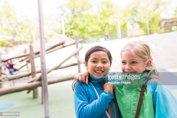 Girls (8-9) embracing outdoors