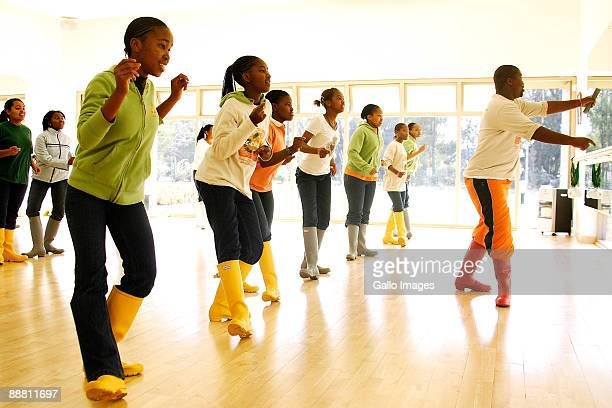 Girls enjoy a dance lesson during the academy's art celebration week at the Oprah Winfrey Leadership Academy for Girls on June 16 2009 in...