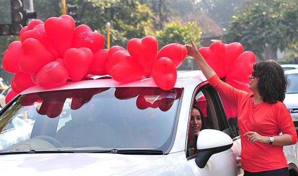 Girls enjoy with heart shape balloons as they celebrated Valentine's Day on February 14 2015 in Chandigarh India Valentine's Day also known as