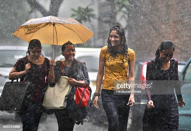 Girls enjoying during the rain at Patel Chowk Metro Station on September 11 2014 in New Delhi India The city has so far recorded 11 mm of rainfall...