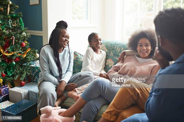 girls enjoying holidays with young man and woman - christmas family stock pictures, royalty-free photos & images