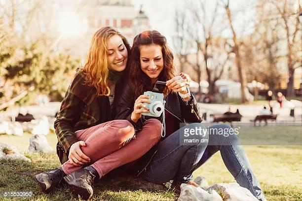 Girls enjoying instant photos