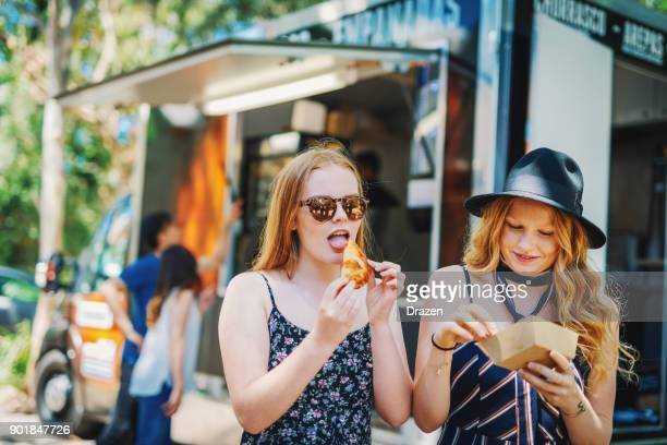 girls enjoying ladie's night together - food truck stock photos and pictures