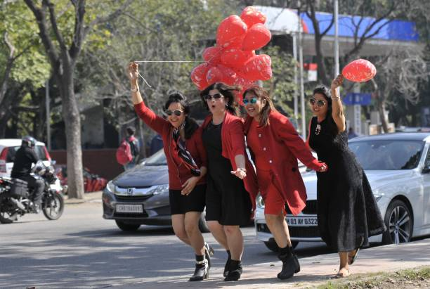 Girls enjoying the Valentine's Day with red balloons at sector 10 on February 14 2017 in Chandigarh India