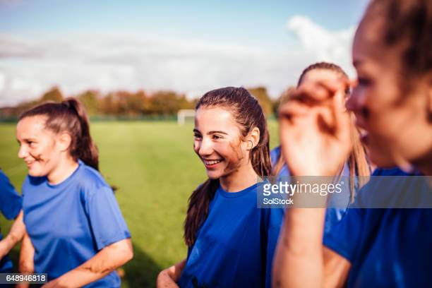girls enjoying their soccer game - rugby team stock pictures, royalty-free photos & images