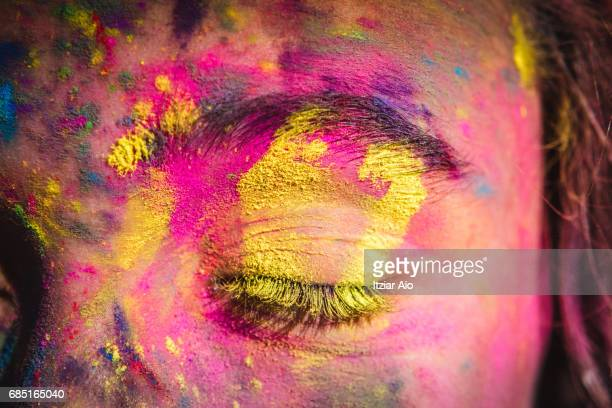 girl's face covered with holi colors