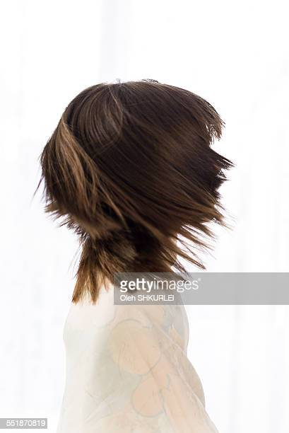 Girl's face profile created with hair motion