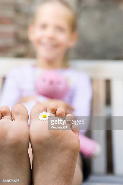 girl's foot holding daisy - female feet soles stock photos and pictures
