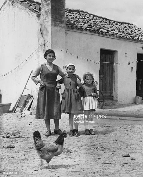 Girls from a farming family in Metaponto in southern Italy circa 1950 The girl on the right is wearing a leg brace