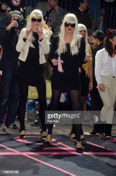 Girls from a 'High Heels' racing team attend the 'High Heel Race' Hosted by Sarenza Shoes at the Piscine Molitor on December 3 2010 in Paris France