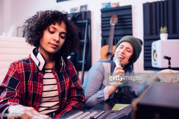 girls from a music group recording a new song for their album - electronic music stock pictures, royalty-free photos & images
