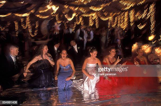Girls from Clay County High School dance at their prom wearing gowns donated by the Hewitt School students in New York Students from the Hewitt...