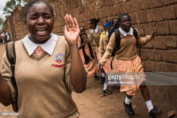 Girls from Gitanga Primary school flee after getting caught between opposition supporters and police who were clashing after Cabinet Secretary Fred...
