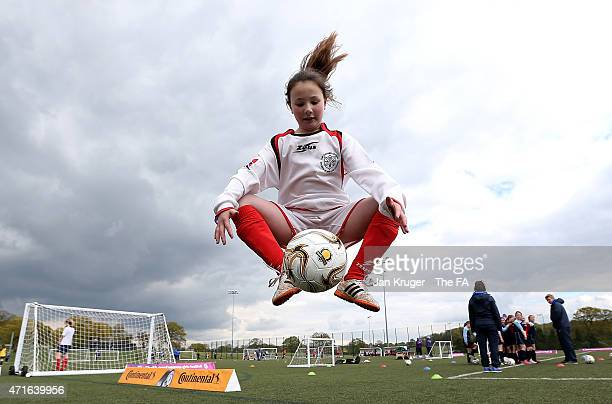 Girls from local schools take part in activities during the FA Girls' Football Festival at St Georges Park on April 30, 2015 in Burton-upon-Trent,...