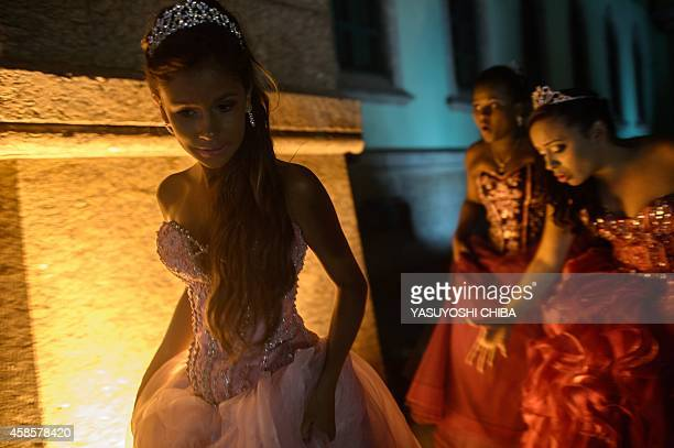 Girls from the CerroCora favela who turn 15 this year head to their debutante ball organized by the Pacifying Police Unit from their community at the...