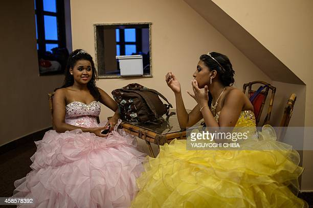 Girls from the CerroCora favela who turn 15 this year wait at the castle at Fiscal Island in Guanabara Bay in Rio de Janeiro Brazil on November 6...