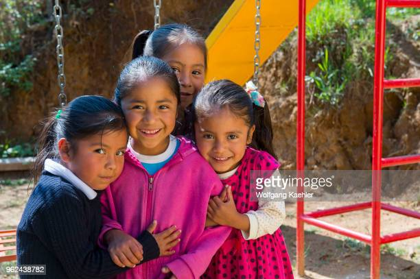 Girls from the kindergarten class on the playground of the school in the Mixtec village of San Juan Contreras near Oaxaca Mexico