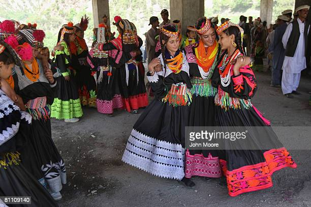 Girls from the polytheistic Kalash tribe dance at the Joshi spring festival May 15, 2008 in the remote Chitral village of Rumbur in northwestern...