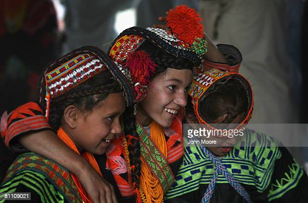 15 Girls from the polytheistic Kalash tribe embrace while dancing at the Joshi spring festival May 15 2008 in the remote Chitral village of Rumbur in...